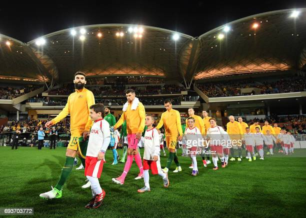 Mile Jedinak of Australia leads his players onto the ground prior to the 2018 FIFA World Cup Qualifier match between the Australian Socceroos and...
