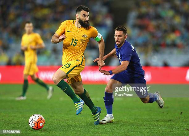 Mile Jedinak of Australia looks upfield during the international friendly match between the Australian Socceroos and Greece at ANZ Stadium on June 4...