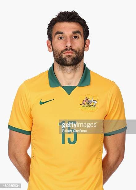 Mile Jedinak of Australia poses during an Australian Socceroos headshot session at the InterContinental Hotel on January 3 2015 in Melbourne Australia