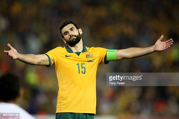 Mile Jedinak of Australia reacts to the referees decision during the Asian Cup Semi Final match between the Australian Socceroos and the United Arab...