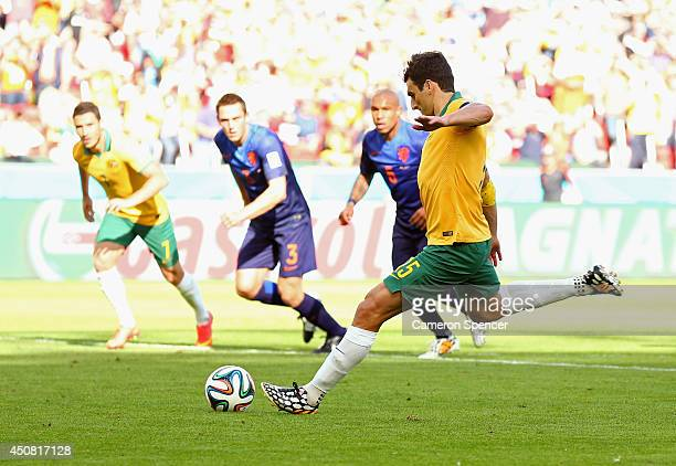 Mile Jedinak of Australia shoots and scores his team's second goal on a penalty kick during the 2014 FIFA World Cup Brazil Group B match between...