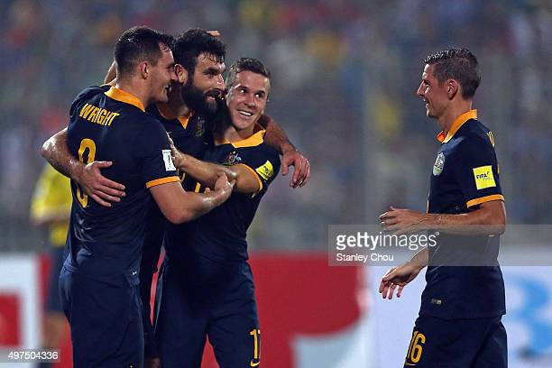 Mile Jedinak of Australia Socceroos celebrates with his team mates after scoring the 4th goal against Bangladesh during the 2018 FIFA World Cup...