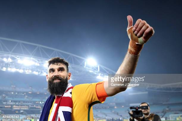 Mile Jedinak of Australia thanks fans after winning the 2018 FIFA World Cup Qualifiers Leg 2 match between the Australian Socceroos and Honduras at...