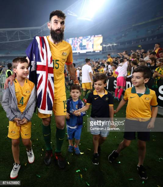 Mile Jedinak of Australia walks a lap with his children and nephews after winning the 2018 FIFA World Cup Qualifiers Leg 2 match between the...