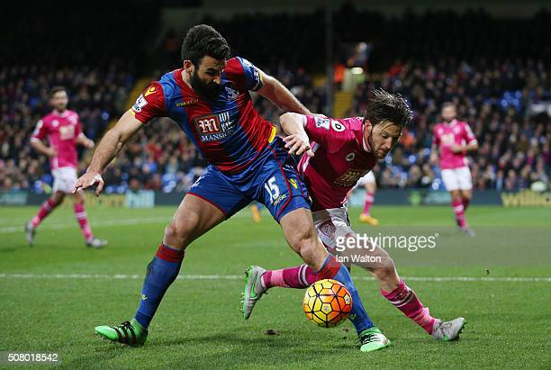 Mile Jedinak of Crystal Palace and Harry Arter of Bournemouth compete for the ball during the Barclays Premier League match between Crystal Palace...