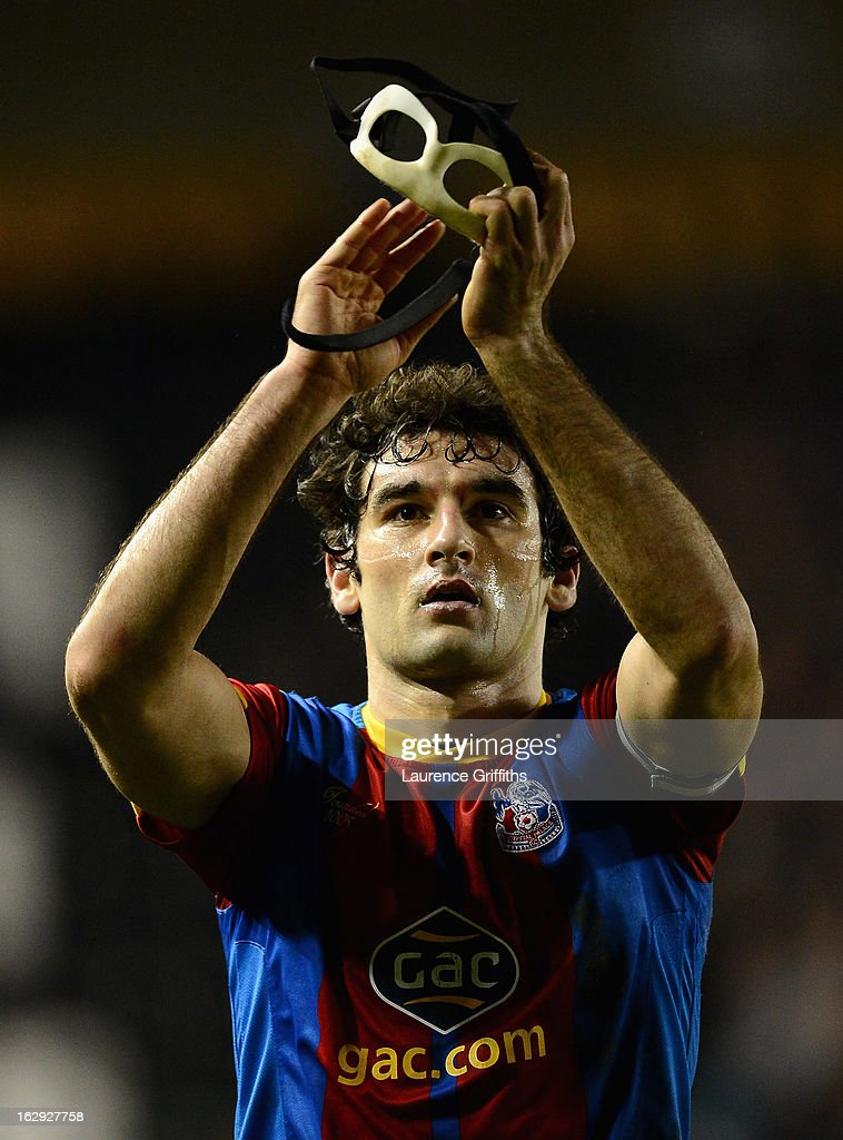 <a gi-track='captionPersonalityLinkClicked' href=/galleries/search?phrase=Mile+Jedinak&family=editorial&specificpeople=3123629 ng-click='$event.stopPropagation()'>Mile Jedinak</a> of Crystal Palace applauds the travelling fans during the npower Championship match between Derby County and Crystal Palace at Pride Park Stadium on March 1, 2013 in Derby, England.