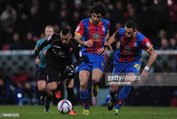 Mile Jedinak of Crystal Palace battles with Ravel Morrison of Birmingham City during the npower Championship match between Crystal Palace and...