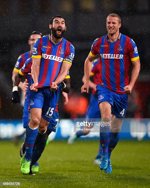 Mile Jedinak of Crystal Palace celebrates scoring his team's third goal with team mates during the Barclays Premier League match between Crystal...