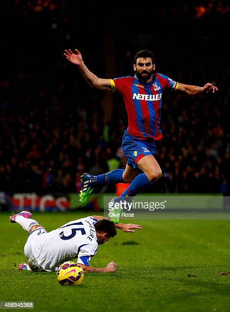 Mile Jedinak of Crystal Palace is tackled by Anthony Reveilliere of Sunderland during the Barclays Premier League match between Crystal Palace and...