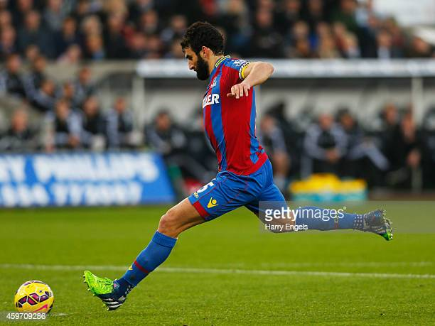 Mile Jedinak of Crystal Palace scores their first and equalising goal from a penalty during the Barclays Premier League match between Swansea City...