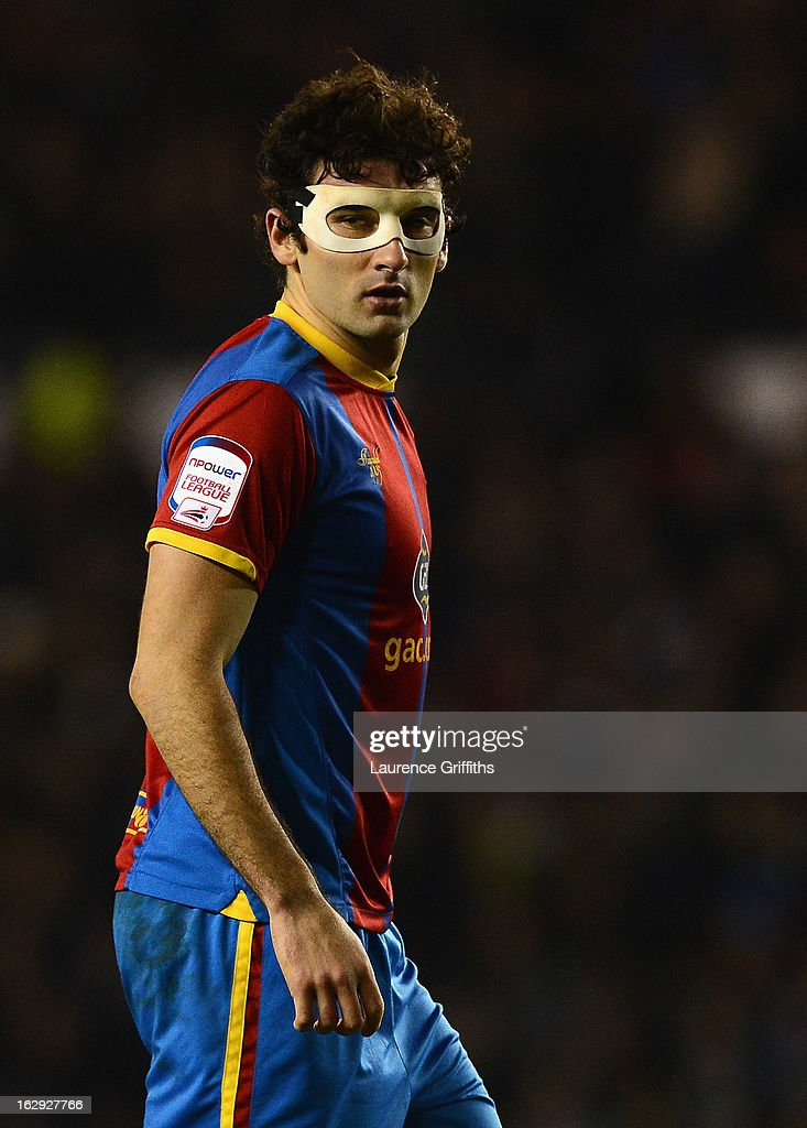 <a gi-track='captionPersonalityLinkClicked' href=/galleries/search?phrase=Mile+Jedinak&family=editorial&specificpeople=3123629 ng-click='$event.stopPropagation()'>Mile Jedinak</a> of Crystal Palace wears face protection during the npower Championship match between Derby County and Crystal Palace at Pride Park Stadium on March 1, 2013 in Derby, England.
