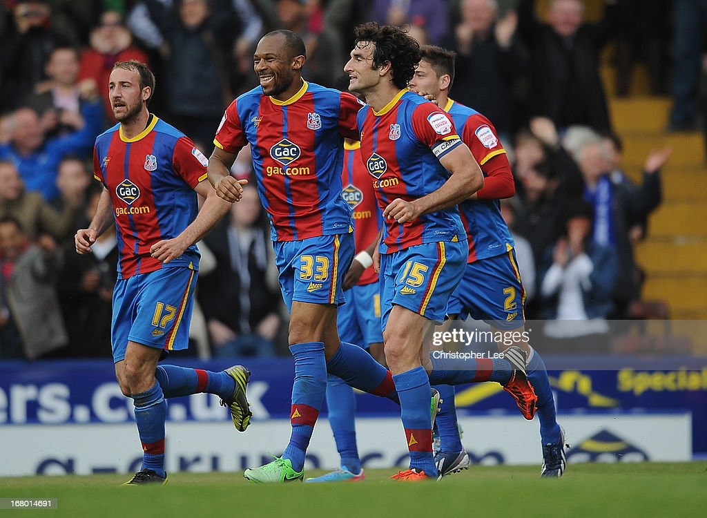 Mile Jedinak of Palace celebrates scoring their winning goal with Danny Gabbidon during the npower Championship match between Crystal Palace and Peterborough United at Selhurst Park on May 04, 2013 in London, England.
