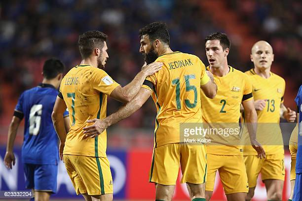 Mile Jedinak of the Socceroos celebrates with his team after scoring Australia's first goal during the 2018 FIFA World Cup Qualifier match between...
