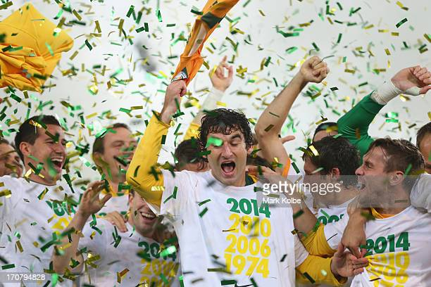 Mile Jedinak of the Socceroos celebrates with his team after their victory in the FIFA 2014 World Cup Asian Qualifier match between the Australian...