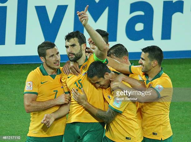 Mile Jedinak of the Socceroos is congratulated by his teammates after scoring a goal during the 2015 Asian Cup match between the Australian Socceroos...