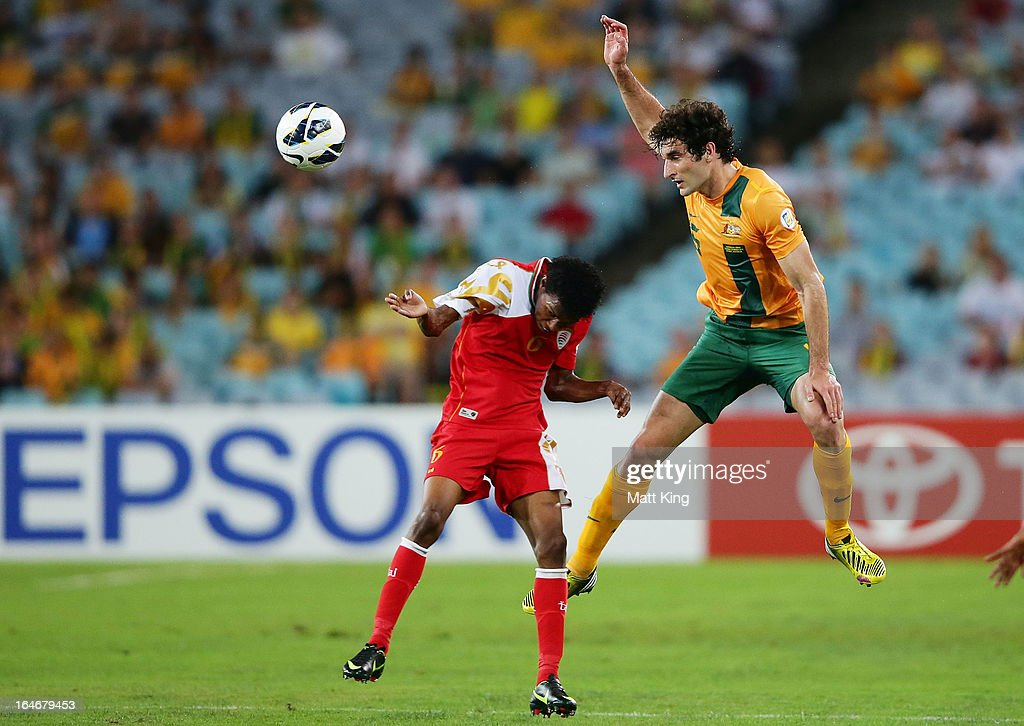 Mile Jedinak of the Socceroos jumps above Raed Saleh of Oman during the FIFA 2014 World Cup Qualifier match between the Australian Socceroos and Oman at ANZ Stadium on March 26, 2013 in Sydney, Australia.