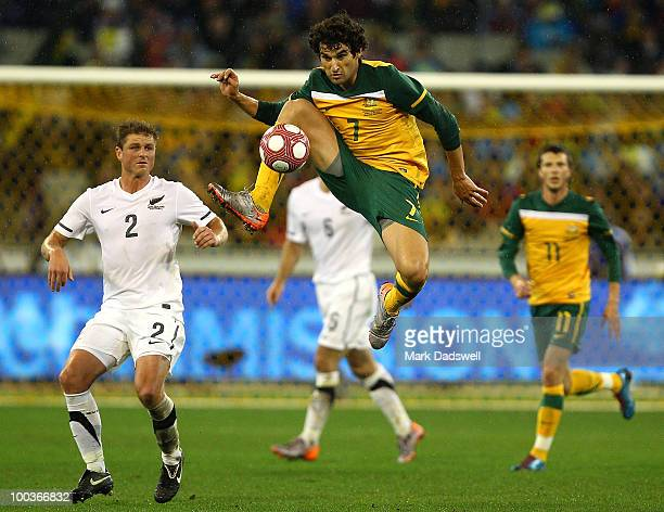 Mile Jedinak of the Socceroos jumps to control the ball during the 2010 FIFA World Cup PreTournament match between the Australian Socceroos and the...