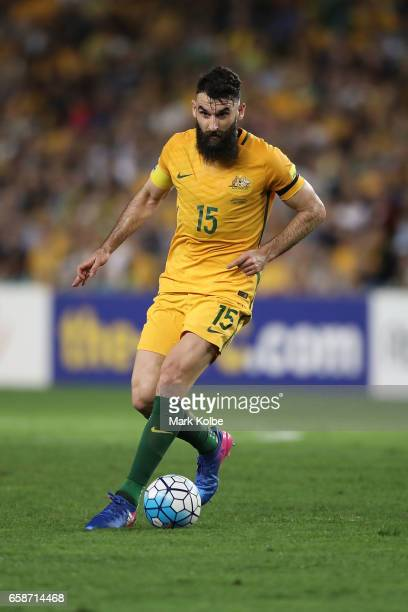 Mile Jedinak of the Socceroos runs the ball forward during the 2018 FIFA World Cup Qualifier match between the Australian Socceroos and United Arab...