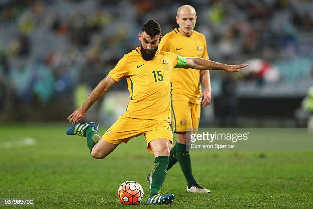 Mile Jedinak of the Socceroos takes a shot at goal during the international friendly match between the Australian Socceroos and Greece at ANZ Stadium...