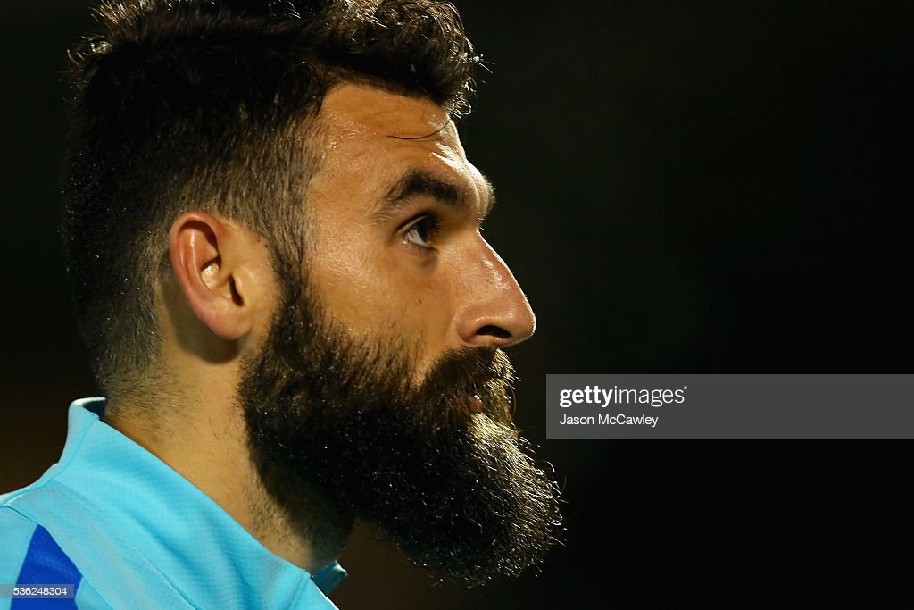 <a gi-track='captionPersonalityLinkClicked' href=/galleries/search?phrase=Mile+Jedinak&family=editorial&specificpeople=3123629 ng-click='$event.stopPropagation()'>Mile Jedinak</a> of the Socceroos watches on during an Australian Socceroos training session at Leichhardt Oval on June 1, 2016 in Sydney, Australia.