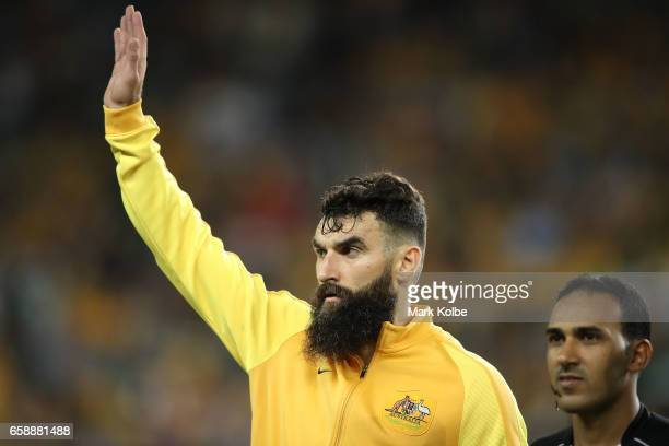Mile Jedinak of the Socceroos waves to the crowd before the anthems during the 2018 FIFA World Cup Qualifier match between the Australian Socceroos...