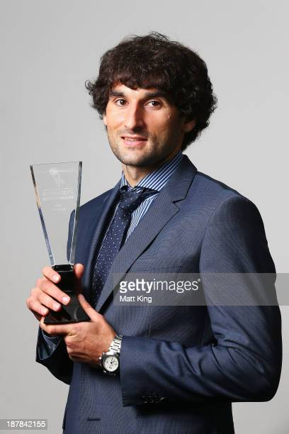 Mile Jedinak poses after winning the male Footballer of the Year award during the 2013 Australian Football Awards at Sydney Convention Exhibition...