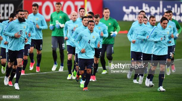 Mile Jedinak Tim Cahill and Mark Milligan of Australia warm up during the Australian Socceroos training session at the Adelaide Oval on June 7 2017...