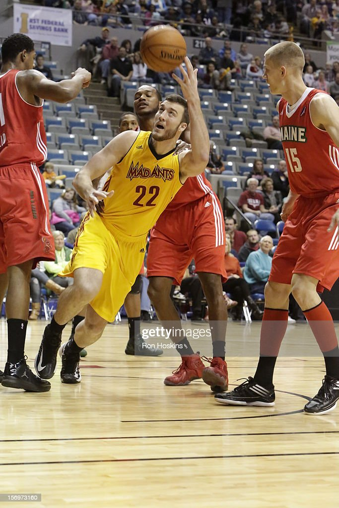 Mile Plumlee #22 of the Fort Wayne Mad Ants battles <a gi-track='captionPersonalityLinkClicked' href=/galleries/search?phrase=Micah+Downs&family=editorial&specificpeople=491038 ng-click='$event.stopPropagation()'>Micah Downs</a> #15 Maine Red Claws at Allen County Memorial Coliseum on November 25, 2010 in Fort Wayne, Indiana.