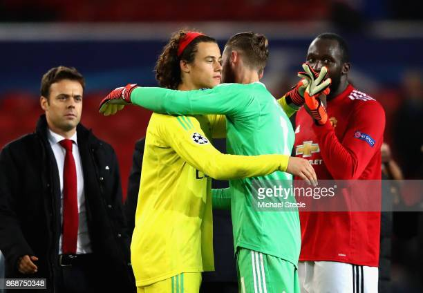 Mile Svilar of Benfica and David De Gea of Manchester United embrace following the UEFA Champions League group A match between Manchester United and...