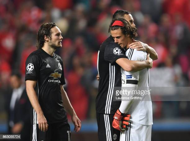 Mile Svilar of Benfica is consoled by Nmanja Matic and Daley Blind of Manchester United after the UEFA Champions League group A match between SL...