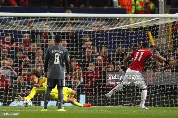 Mile Svilar of Benfica saves the shot of Anthony Martial of Manchester United during the UEFA Champions League group A match between Manchester...