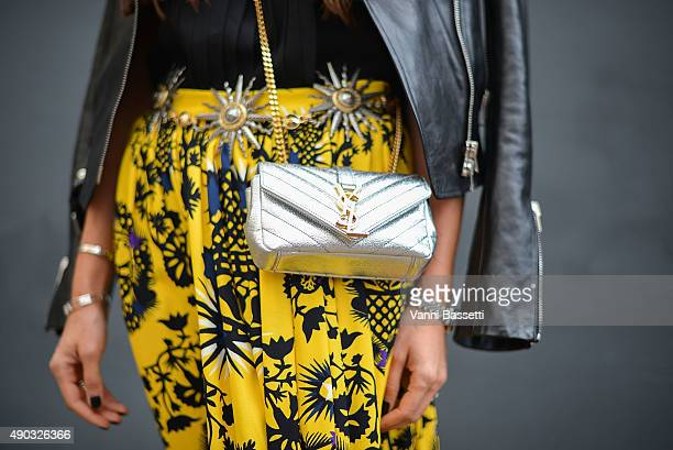 Milena Giordano poses wearing a MSGM skirt and a YSL bag before the MSGM show during the Milan Fashion Week Spring/Summer 16 on September 27 2015 in...