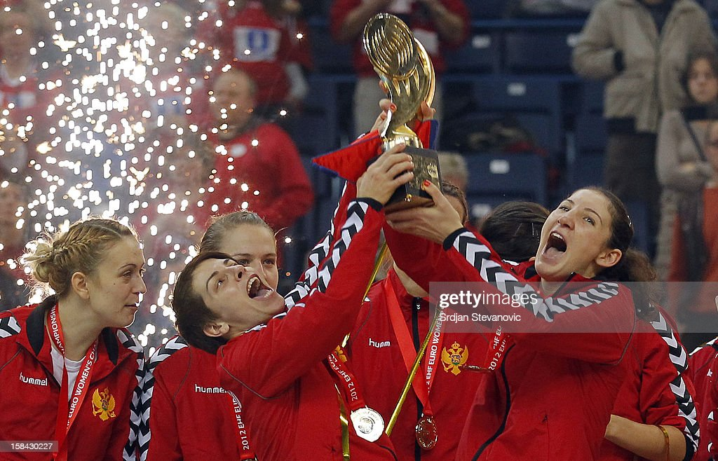 Milena Knezevic (R) and Ana Dokic (L) of Montenegro lift the trophy during the Women's European Handball Championship 2012 medal ceremony at Arena Hall on December 16, 2012 in Belgrade, Serbia.