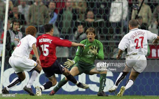 Milenko Acimovic of Lille scores the first goal during the UEFA Champions League match between Lille and Manchester United at the Stade de France on...