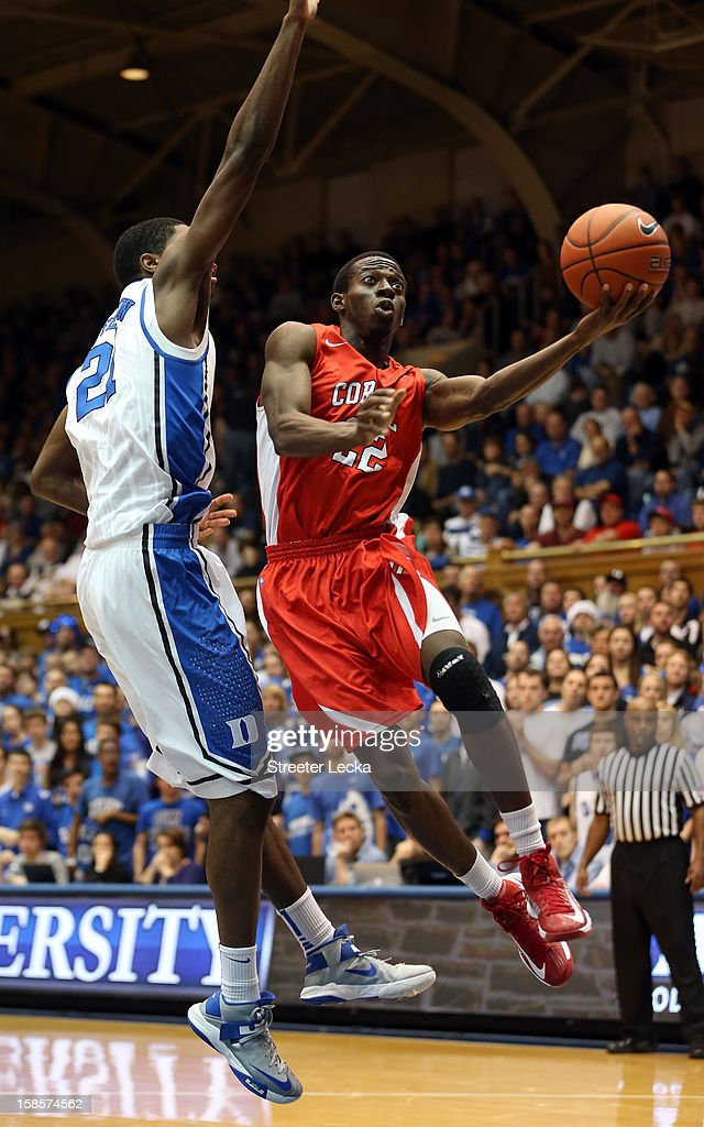 Miles Asafo-Adjei #22 of the Cornell Big Red drives past Amile Jefferson #21 of the Duke Blue Devils during their game at Cameron Indoor Stadium on December 19, 2012 in Durham, North Carolina.