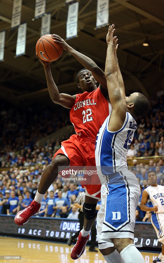 Miles Asafo-Adjei #22 of the Cornell Big Red shoots over Josh Hairston #15 of the Duke Blue Devils during their game at Cameron Indoor Stadium on December 19, 2012 in Durham, North Carolina.