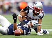 Miles Austin of the Dallas Cowboys fumbles the ball as Patrick Chung of the New England Patriots defends on October 16 2011 at Gillette Stadium in...