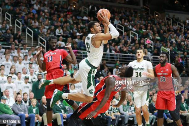 Miles Bridges of the Michigan State Spartans draws a blocking foul from Tyrell Sturdivant of the Stony Brook Seawolves at Breslin Center on November...