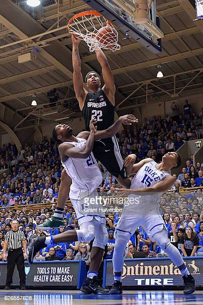 Miles Bridges of the Michigan State Spartans dunks over Amile Jefferson and Frank Jackson of the Duke Blue Devils during the game at Cameron Indoor...