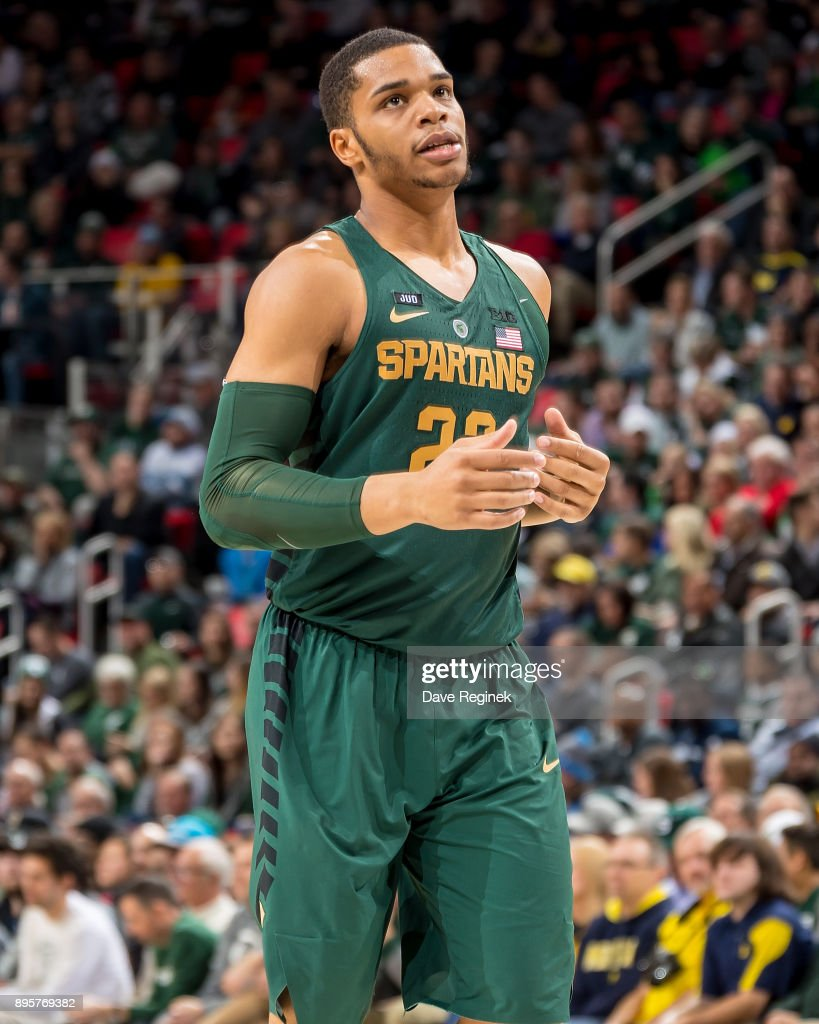 Miles Bridges #22 of the Michigan State Spartans runs up court against the Oakland Golden Grizzlies during game two of the Hitachi College Basketball Showcase at Little Caesars Arena on December 16, 2017 in Detroit, Michigan. The Spartans defeated the Grizzles 86-73.