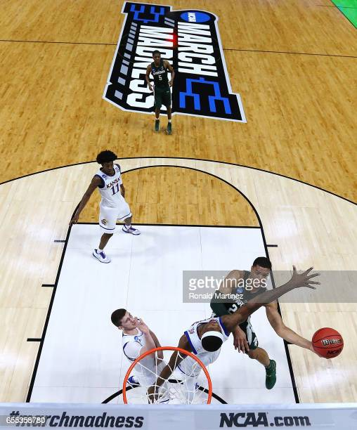 Miles Bridges of the Michigan State Spartans takes a shot against Carlton Bragg Jr #15 of the Kansas Jayhawks during the second round of the 2017...