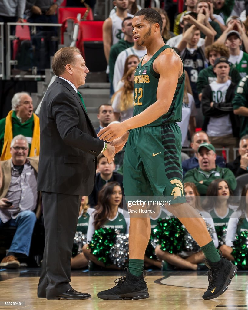 Miles Bridges #22 of the Michigan State Spartans walks over to Head coach Tom Izzo during game two against the Oakland Golden Grizzlies of the Hitachi College Basketball Showcase at Little Caesars Arena on December 16, 2017 in Detroit, Michigan. The Spartans defeated the Grizzles 86-73.