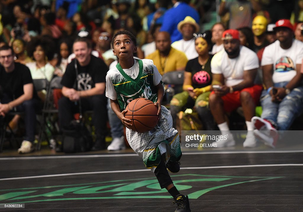 Miles Brown participates in the Celebrity Basketball Game at BET Experience at the Convention Center in Los Angeles, on June 25, 2016. / AFP / CHRIS