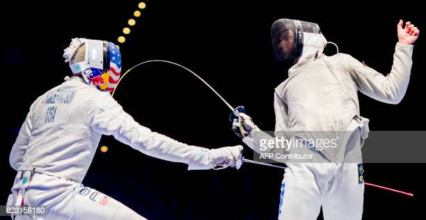 TOPSHOT US Miles ChamleyWatson and Italian Alessio Voconi vie during the team men's foil final between USA and Italy at the World Fencing...