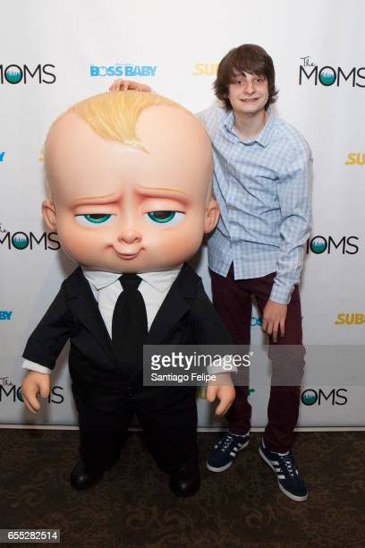 Miles Christopher Bakshi and Boss Baby attend Mamarazzi Screening Of 'The Boss Baby' at Dolby 88 Theater on March 19 2017 in New York City