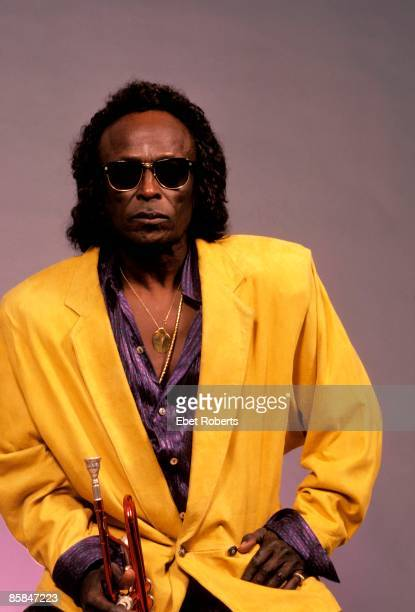 Photo of Miles DAVIS posed studio wearing sunglasses
