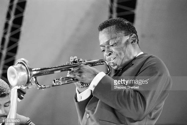 Miles Davis sweating as he plays trumpet at the Randall's Island Jazz Festival in New York