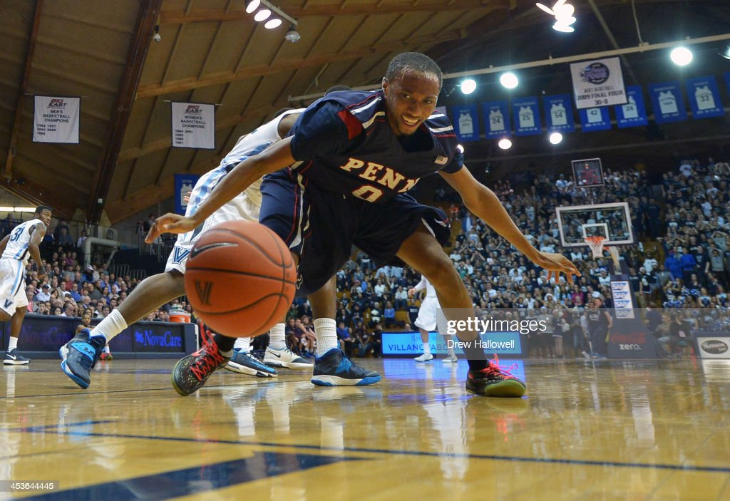 Miles Jackson-Cartwright #0 of the Pennsylvania Quakers scrambles for a loose ball against the Villanova Wildcats at the Pavilion on December 4, 2013 in Villanova, Pennsylvania. Villanova won 77-54.