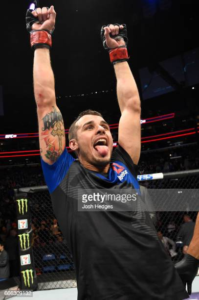 Miles Jury celebrates his technical knockout victory over Mike De La Torre in their featherweight bout during the UFC 210 event at KeyBank Center on...