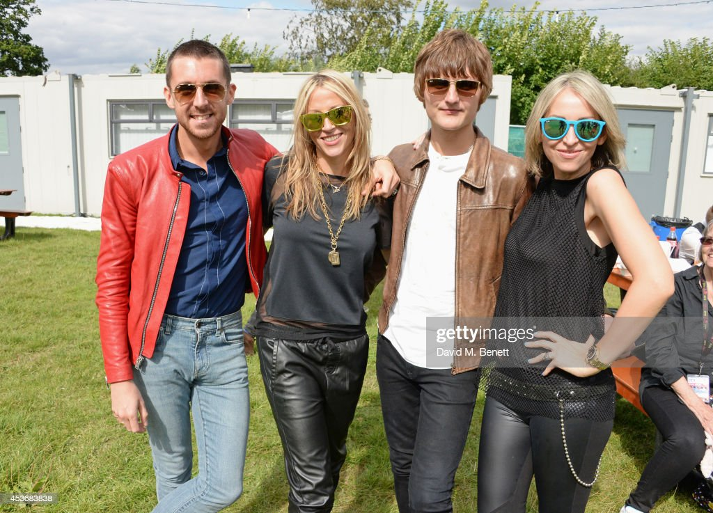 <a gi-track='captionPersonalityLinkClicked' href=/galleries/search?phrase=Miles+Kane&family=editorial&specificpeople=4860678 ng-click='$event.stopPropagation()'>Miles Kane</a>, <a gi-track='captionPersonalityLinkClicked' href=/galleries/search?phrase=Nicole+Appleton&family=editorial&specificpeople=211518 ng-click='$event.stopPropagation()'>Nicole Appleton</a>, Jay Sharrock and <a gi-track='captionPersonalityLinkClicked' href=/galleries/search?phrase=Natalie+Appleton&family=editorial&specificpeople=213006 ng-click='$event.stopPropagation()'>Natalie Appleton</a> attend the Mahiki Rum Bar for the launch of the Mahiki Rum Family backstage during day 1 of the V Festival 2014 at Hylands Park on August 16, 2014 in Chelmsford, England.